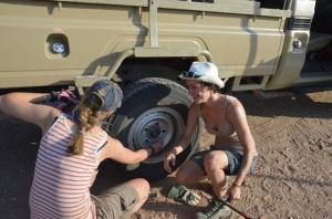 Volunteer's changing a wheel