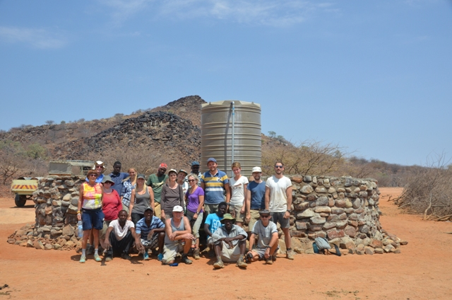 Volunteers at the completed wall