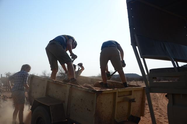Volunteers unloading sand