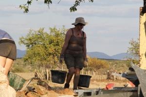 Volunteer carrying water
