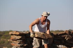 Volunteer carrying a rock