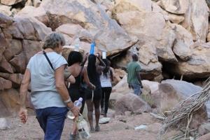 Volunteers walkin with waterbottels on their heads