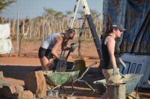 Volunteer mixing cement