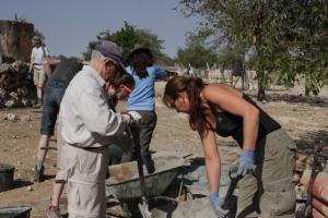 Volunteers mixing cement