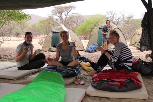 Volunteers sitting under the tarpaulin.jpg