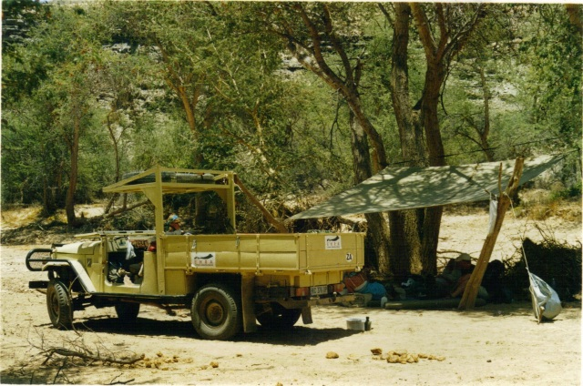 camp-set-up-with-old-cruiser