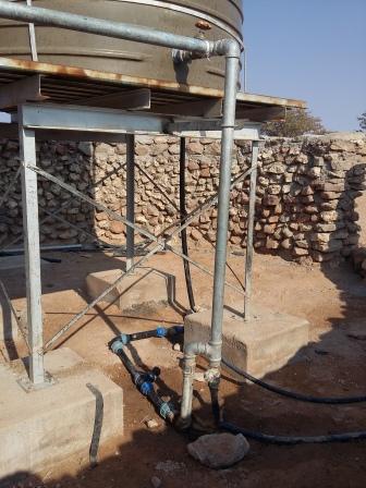 Fixing walls+tank+pipes+trough+dam at Omungambu (15)